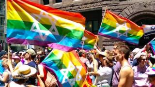 Rainbow flags with stars of david