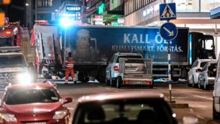 The truck (bottom, blue) that crashed into the Ahlens department store at Drottninggatan in central Stockholm