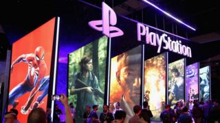 Posters featuring Spiderman and other games at E3