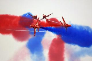 Red Arrows performing at the Sunderland International Airshow with coloured smoke in the sky