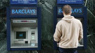 Man using Barclays ATM machine