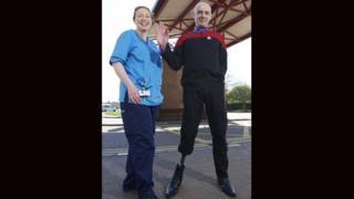 Eddy McGurty wit NHS Highland's Elaine McCurrach