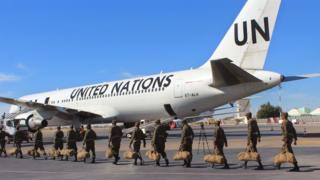Mauritanian soldiers board a United Nations flight to Central African Republic as a peacekeeping force in Nouakchott, Mauritania, Sunday, Feb 21, 2016.