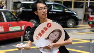 A man campaigns for Susi Law, a candidate in Sunday's district council elections in Hong Kong, China November 23, 2019