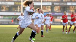 Abby Dow of England breaks before scoring a try during the Wales Women and England Women match in the Women's Six Nations at Cardiff Arms Park on February 24, 2019 in Cardiff, Wales.