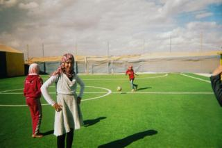 football Girls train on a football pitch
