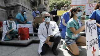 "Healthcare workers kneel in silence during a protest at Columbus Circle, 12 days on after George Floyd""s death in police custody, in New York, USA, 06 June 2020"