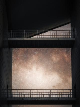 The milky way viewed through the minimalist outdoor passageway at the National Astronomical Observatory of China