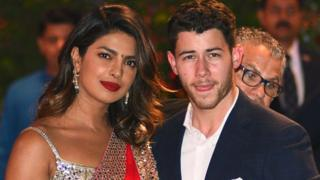 Priyanka Chopra and Nick Jonas arriving at a party together in June
