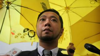 Political activist Ken Tsang addresses the media outside the Kowloon city court in Hong Kong on 26 May 2016