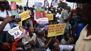 Demonstrators rally at the Ballot Tabulation Center in Sonapi, to protest against the Provisional Electoral Council, the election results and also to request an independent commission to review the election outcome, in Port-au-Prince on December 16, 2015.