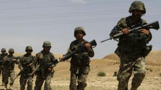 Afghan National Army (ANA) soldiers conduct a patrol outside the village of But Khak on the outskirts of Kabul May 15, 2012