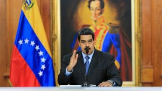 handout picture released by the Venezuelan presidency showing Venezuelan President Nicolas Maduro talking during a television programme at the Miraflores presidential palace in Caracas on August 7, 2018.