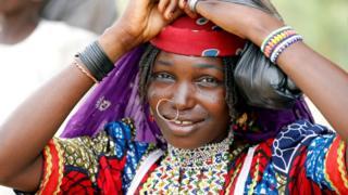 A Fulani woman fixes her head scalf on the street of Dapchi, Yobe state, Nigeria February 27, 2018