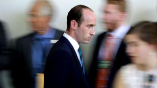 Stephen Miller walks quickly to Rose Garden