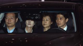 Ousted South Korean president Park Geun-hye leaves the prosecutors' office as she is transferred to a detention house in Seoul
