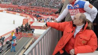 Russian President Vladimir Putin watches downhill ski competition of the 2014 Winter Paralympics Games in Sochi