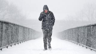 Pedestrian in the snow