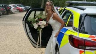 Bride stepping out of police car