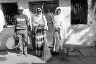 Sanitation workers, Geeta Mattu, Sashi Balmeek and Raju Dumar, in Panna District, India.