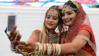 Indian brides taking a selfie