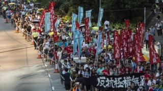 Protesters march in Hong Kong on August 20, 2017