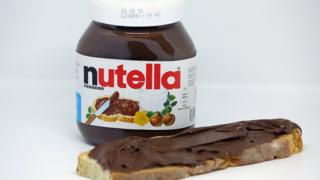 Jar of Nutella and piece of toast