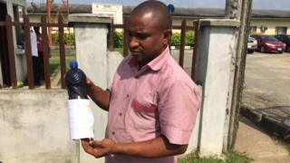 Man carry bottle of wetin fit be kpofire