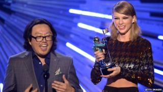 Joseph Kahn on stage with Taylor Swift at the MTV VMAs