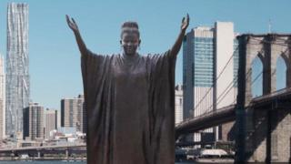 A simulation of how the final statue will look when it is unveiled in New York