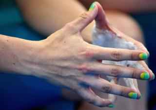 Ashlee Ankudinoff of Australia holds her hands together at a cycling event