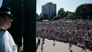 A policeman watching over crowds at Wimbledon 2015