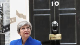 Prime Minister Theresa May pictured in front of 10 Downing Street on 9 June after she travelled to Buckingham Palace for an audience with Queen Elizabeth II following the General Election results.