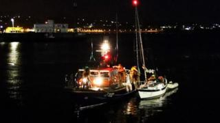 Douglas lifeboat Sir William Hillary with casualty vessel in Douglas harbour.