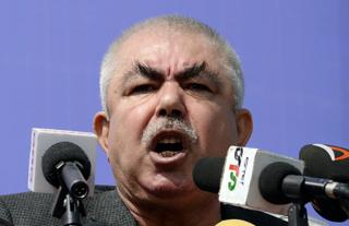 Abdul Rahid Dostum addresses a crowd in the outskirts of Kunduz province, north of Kabul, on March 19, 2014.