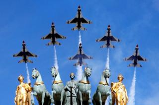 The U.S. Air Force Thunderbirds fly over the Arc de Triomphe du Carrousel during the traditional Bastille Day military parade in Paris, France,