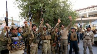 Afghan security forces celebrate neutralising gunmen who stormed a government building in Afghanistan's eastern city of Jalalabad, July 31 2018