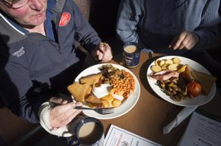 Two men eat a fry-up