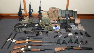 A cache of guns and ammunition uncovered by US federal investigators in the home of Coast Guard lieutenant Christopher Paul Hasson in Silver Spring, Maryland. on February 20, 2019