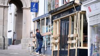 animals Boarding up shops ahead of Shrove Tuesday Football in Ashbourne