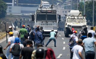 Protesters clash with police in Caracas on 30 April