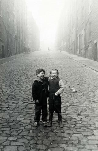 Two children on the cobbled streets of Edinburgh, 1966.