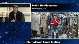 Brad Pitt speaks to astronaut