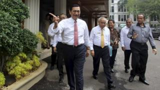 Luhut Pandjaitan, Indonesia's coordinating political, legal and security affairs minister, gestures as he walks with officials to a news conference in Jakarta