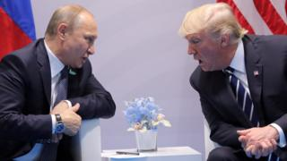 US President Donald Trump (R) speaks with Russian President Vladimir Putin at G20 in Hamburg, 7 Jul 17