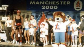 Mr Motivator, a mascot and some children on stage at an event in Manchester on the day in 1993 the 2000 Olympics host city was announced