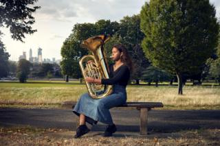 Hanna Mbuya and her Tuba in Denmark Hill, London