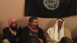 Mohammed Haydar Zammar (centre) attends a meeting between IS militants and Syrian tribal leaders in 2014