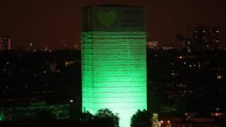 Grenfell tower illuminated green