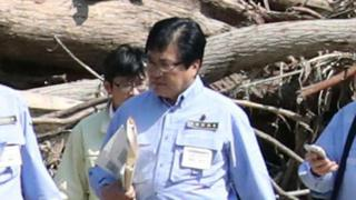 Shunsuke Mutai, Japan's vice minister of reconstruction, visits Iwaizumi, a northern Japanese town devastated by a deadly storm, northern Japan.